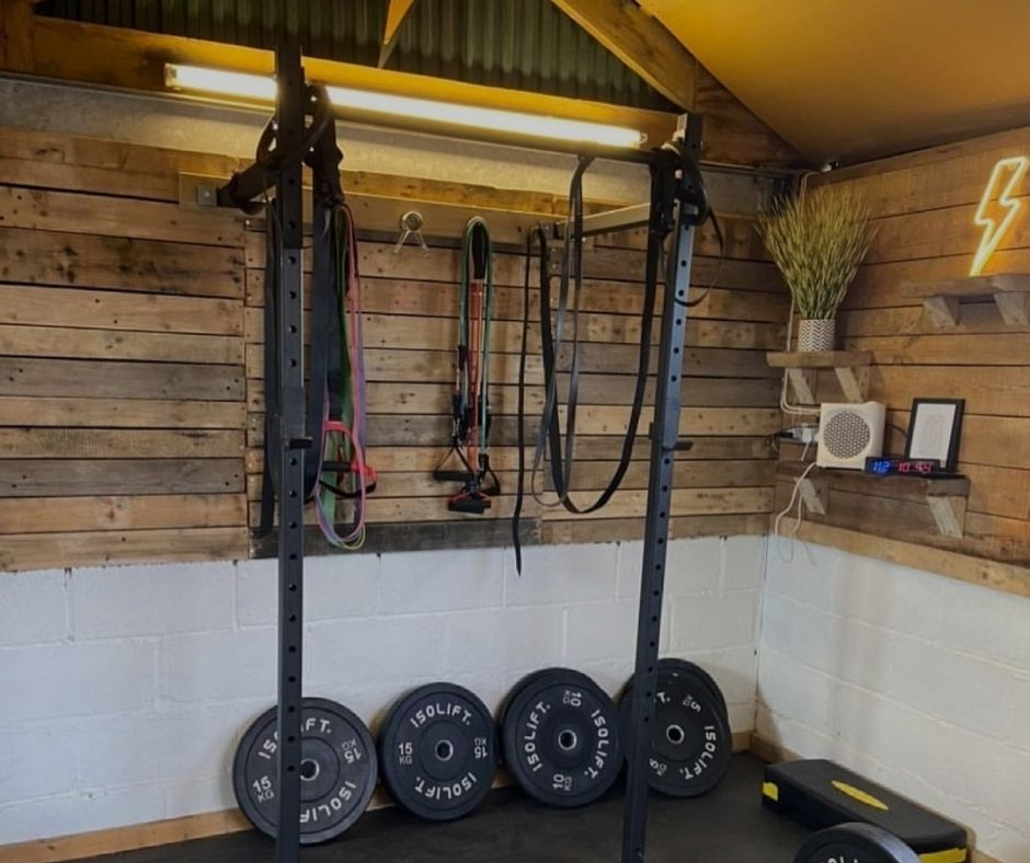 JJ's shed gym with a wall mounted rack